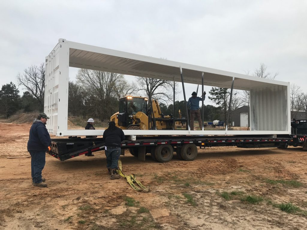 Containers being moved to factory in Durant